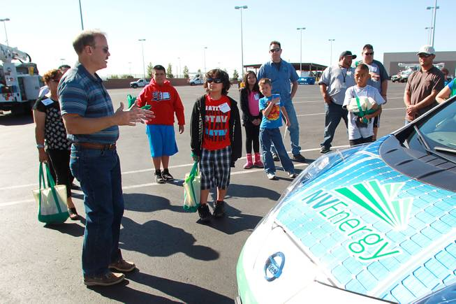 "Todd Seibert talks about an electric car during ""Take Our Daughters and Sons to Work Day"" at NV Energy Thursday, April 24, 2014."