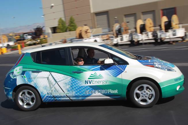 "Gregg Parlade gets a ride in an electric car during ""Take Our Daughters and Sons to Work Day"" at NV Energy Thursday, April 24, 2014."