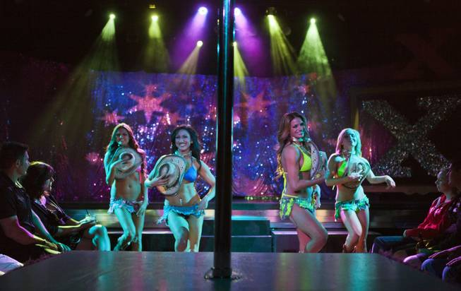 "Dancers perform to a country song as ""X Burlesque"" celebrates its 12th anniversary in Las Vegas on Wednesday, April 23, 2014, at the Flamingo."