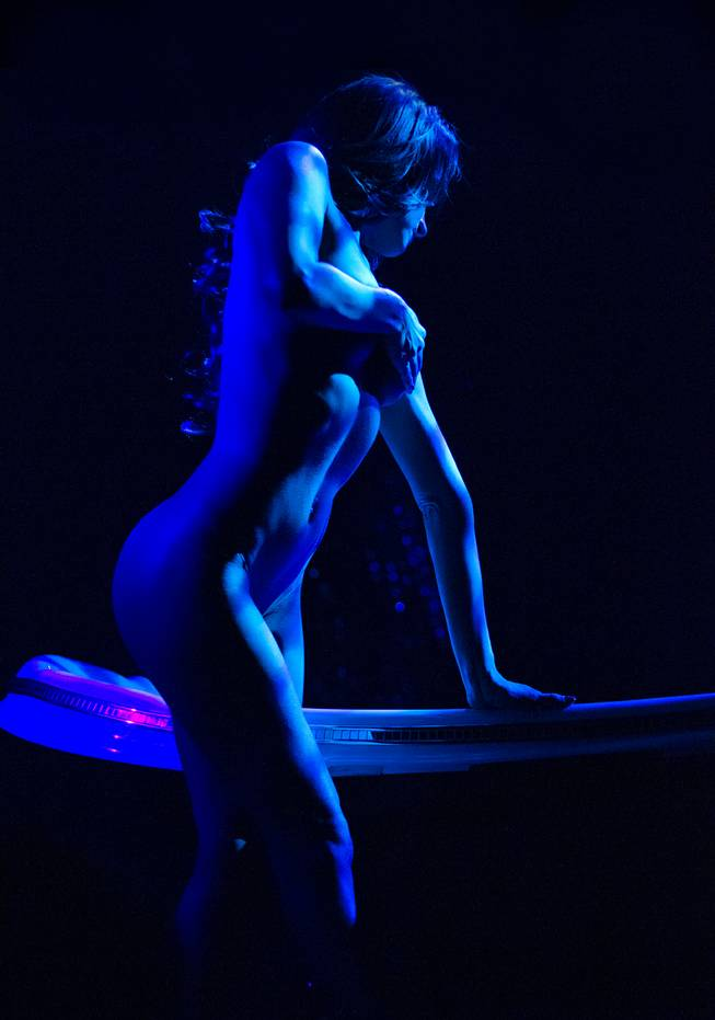 "A dancer is bathed in blue light as ""X Burlesque"" celebrates its 12th anniversary in Las Vegas on Wednesday, April 23, 2014, at the Flamingo."