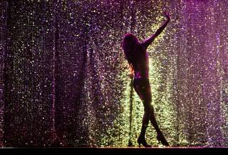 "A dancer is bathed in purple light as ""X Burlesque"" celebrates its 12th anniversary in Las Vegas on Wednesday, April 23, 2014, at the Flamingo."