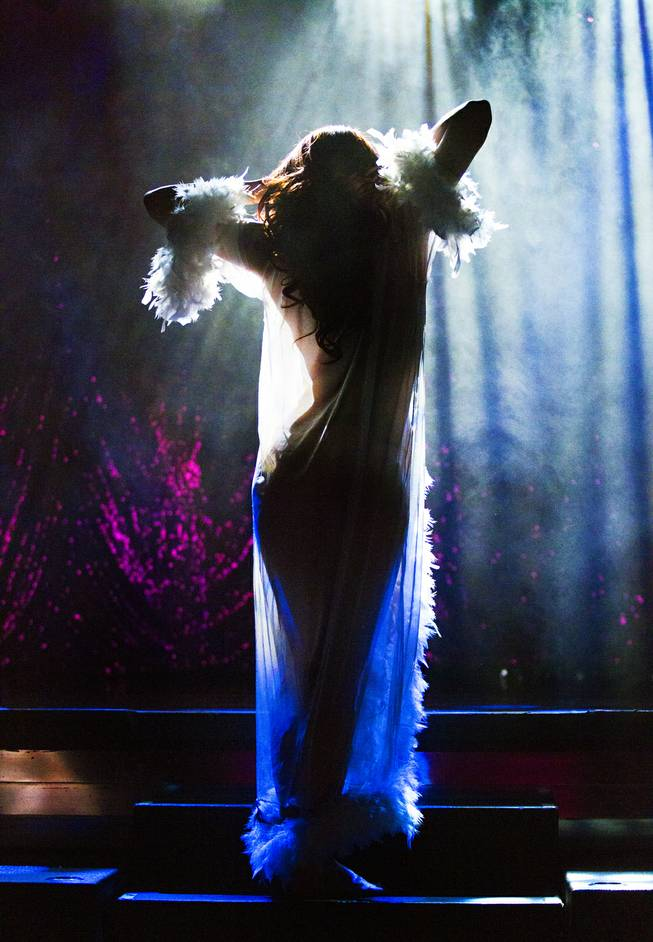 "A dancer is back lit as ""X Burlesque"" celebrates its 12th anniversary in Las Vegas on Wednesday, April 23, 2014, at the Flamingo."