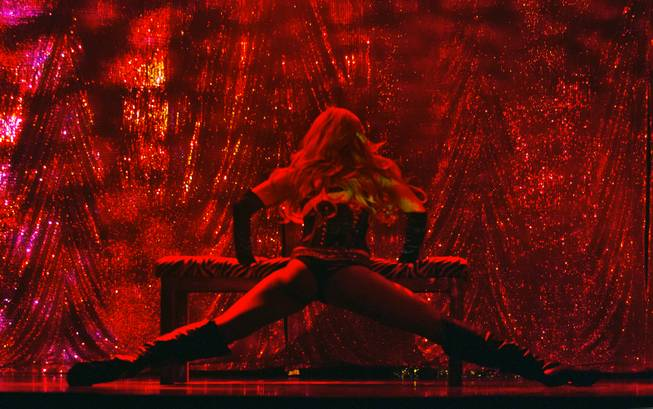 "A dancer is bathed in red light as ""X Burlesque"" celebrates its 12th anniversary in Las Vegas on Wednesday, April 23, 2014, at the Flamingo."