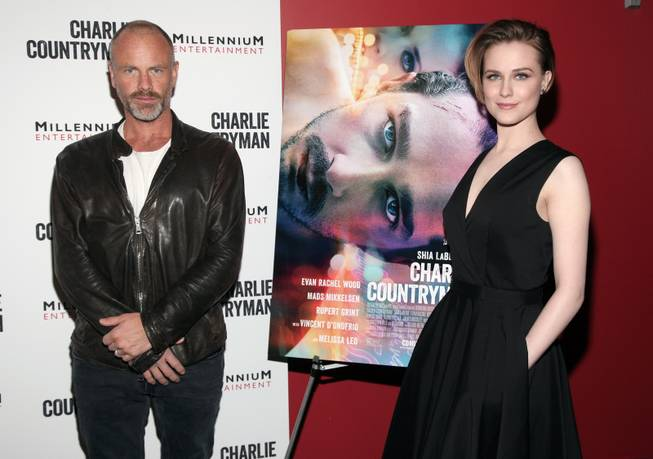 "Director Fredrik Bond, left, and actress Evan Rachel Wood, right, attend a screening of ""Charlie Countryman"" on Wednesday, Nov. 13, 2013 in New York."