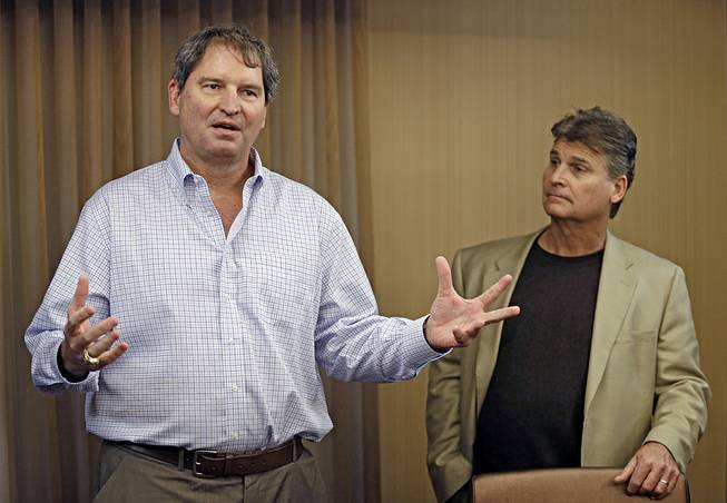 Former Cleveland Browns quarterback Bernie Kosar speaks at a news conference with Dr. Rick Sponaugle in Middleburg Heights, Ohio, on Jan. 10, 2013. Kosar believes he's been unfairly sacked as a TV broadcaster.