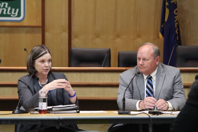 Commissioners Janet Carlson and Samuel Brentano speak at an emergency meeting of the Marion County Commission in Salem, Ore., on Thursday, April 24, 2014. The commission has ordered an incinerator to stop accepting boxed medical waste to generate electricity after learning the waste it's been burning may include tissue from aborted fetuses from British Columbia.