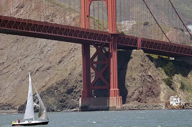 A sailboat makes its way under the Golden Gate Bridge on Wednesday, April 23, 2014, in San Francisco. A National Oceanic and Atmospheric Administration team has found the shipwreck of the City of Chester vessel in the area.