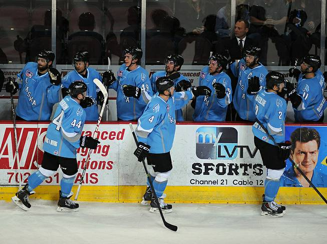 Alaska Aces players skate along their bench in celebration after scoring a first period goal against the Las Vegas Wranglers on Friday night at the Orleans Arena.