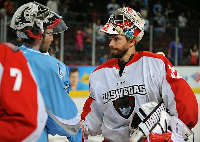 Las Vegas Wranglers goaltender Travis Fullerton shakes hands with Alaska Aces goaltender Olivier Roy after the Aces defeated the Wranglers 4-3 on Friday night at the Orleans Arena. The Aces eliminated the Wranglers in four straight games to end their season.