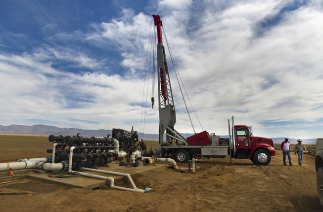 A well-drilling crew works to tap into the water table at the new Kingman Farms owned by Las Vegas developer Jim Rhodes outside Kingman, Ariz., on Wednesday, April 9, 2014.