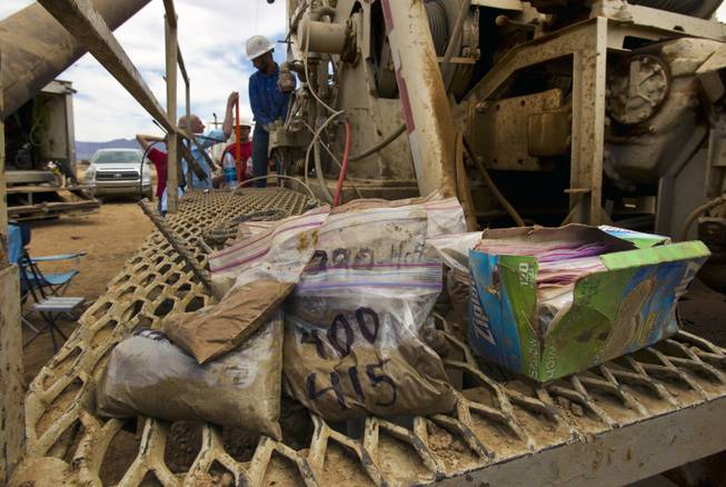 Core samples are collected at a water-drilling rig and collection pool at their new Kingman Farms outside Kingman, Ariz., on Wednesday, April 9, 2014.