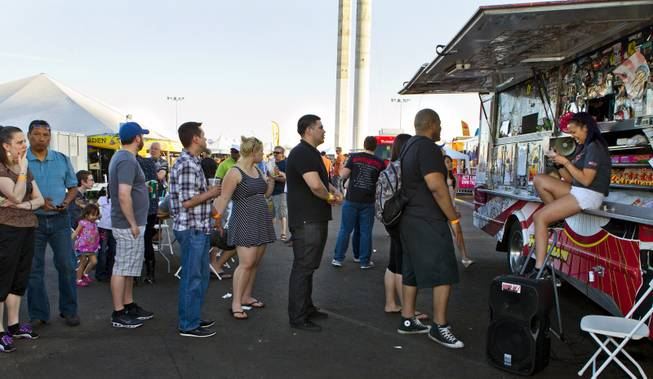 Customers stand in line to place orders at Fukuburger during the Third Annual Las Vegas Foodie Fest across from the Luxor Hotel on Thursday, April 24, 2014.