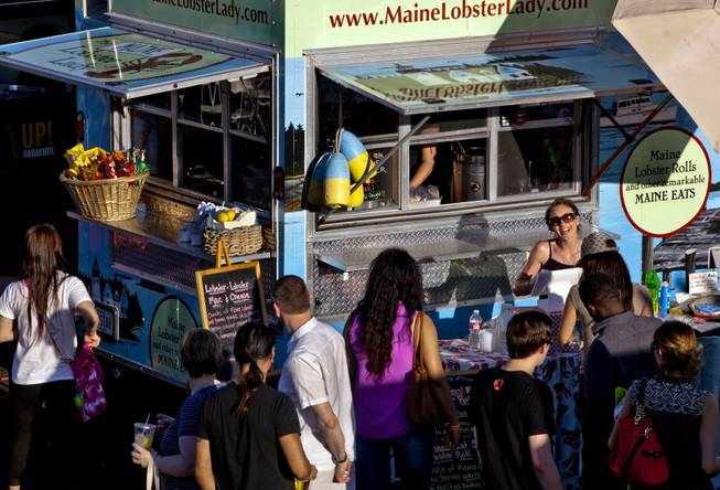 Visitors stroll about and order food at the Third Annual Las Vegas Foodie Fest across from the Luxor Hotel on Thursday, April 24, 2014.