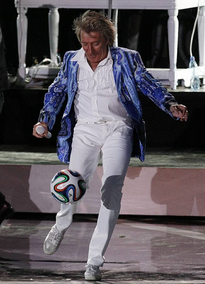 Rod Stewart kicks a soccer ball to the crowd as he performs at the Vina del Mar International Song Festival in Vina del Mar, Chile, Thursday, Feb. 27, 2014.