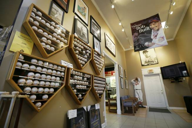 "Autographed baseballs and photographs are displayed at the Bob Feller Museum, Friday, April 11, 2014, in Van Meter, Iowa. Just three years after the death of the ""Heater from Van Meter,"" the museum built in 1995 to honor the former Indians star finds itself gasping for life."