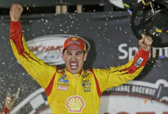 Joey Logano celebrates his win in the NASCAR Sprint Cup auto race at Richmond International Raceway in Richmond, Va., Saturday, April 26, 2014.