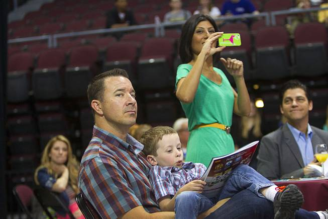 Rian Glassford and his son Dain, 5, attend the Animal Foundation's 11th annual Best in Show competition at the Orleans Arena Sunday, April 27, 2014. Radio personality Dayna Roselli takes a photo in the background.