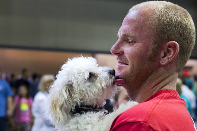 Travis Davis gets kiss from Turbo during the Animal Foundation's 11th annual Best in Show at the Orleans Arena Sunday, April 27, 2014. Davis provided a foster home for Turbo before the show and was given the first option on adopting the dog.