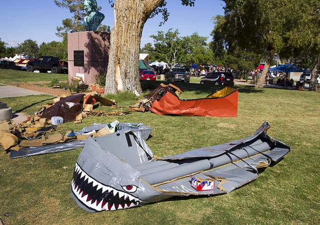 The remains of cardboard boats used in the Cardboard Regatta are shown by the pond during the second annual Pirate Festival Las Vegas in Lorenzi Park Sunday, April 27, 2014.