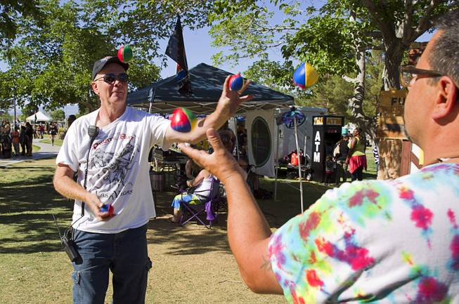 Rich Strelak, left, owner of Pirate Fest, and Paul Dicianno juggle during the second annual Pirate Festival Las Vegas in Lorenzi Park Sunday, April 27, 2014.