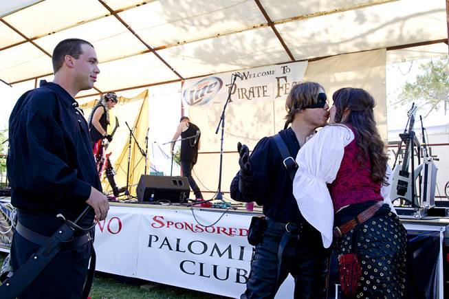 "The ""Masked Pirate"" steals a kiss from audience member Skye Spindler as Scott Santee looks on during the second annual Pirate Festival Las Vegas in Lorenzi Park Sunday, April 27, 2014."