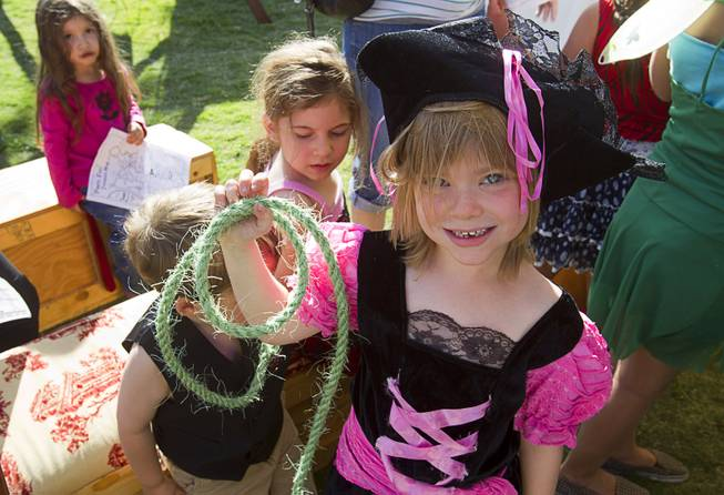 Reya Bacon, 6, poses with a rope that she made during the second annual Pirate Festival Las Vegas in Lorenzi Park Sunday, April 27, 2014.