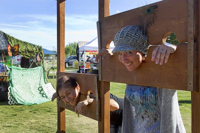 Angie Campa, left, and Gwendolyn Mentzel pose in stocks during the second annual Pirate Festival Las Vegas in Lorenzi Park Sunday, April 27, 2014.
