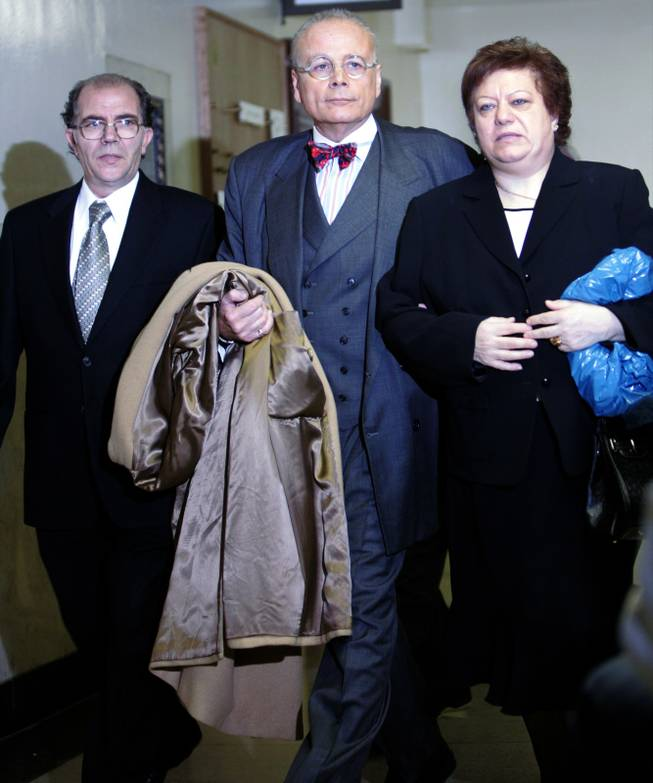Lillo, left, and Dominique Brancato, right, arrive at Bronx criminal court with lawyer Mel Sachs on Jan. 9, 2006 in New York. Lillo Brancato Jr. and Steven Armento were arraigned on charges of second-degree murder, burglary and weapon possession in the death of off duty officer Daniel Enchautegui. Armento, the alleged triggerman, was additionally charged with two counts of first-degree murder.