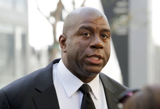 "In this Feb. 21, 2013, photo, former Los Angeles Lakers player Earvin ""Magic"" Johnson arrives at a memorial service for Jerry Buss in Los Angeles. Johnson is calling upon NBA Commissioner Adam Silver to ""come down hard"" on Los Angeles Clippers owner Donald Sterling, who is alleged to have made racially charged comments. Johnson was a subject of the comments Sterling allegedly made on an audio recording obtained and released by TMZ."