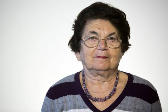 Israeli Holocaust survivor Ester Koffler Paul, 82, originally from what is now Ukraine, poses for a portrait in Jerusalem. Paul was 8, and her sister Nunia was 10 in 1941 when the Nazis invaded their hometown of Buchach in what is now Ukraine. Their mother died before the war and their father was taken by the Nazis and murdered along with 700 other Jewish men.