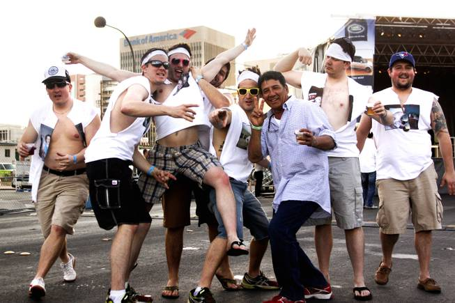 "A bachelor party group for Jared Crawford, second left, pose for a photo during the ""Great Vegas Festival of Beer"" gathering on Fremont East Entertainment District Saturday, April 26, 2014."