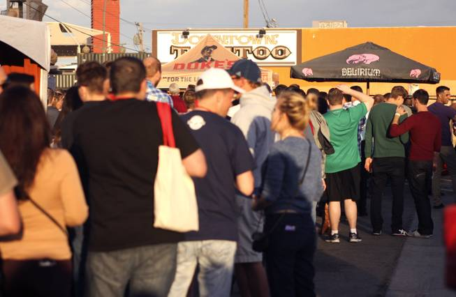 "Festival goers wait in line to get a taste of Delirium beer during the ""Great Vegas Festival of Beer"" gathering on Fremont East Entertainment District Saturday, April 26, 2014."