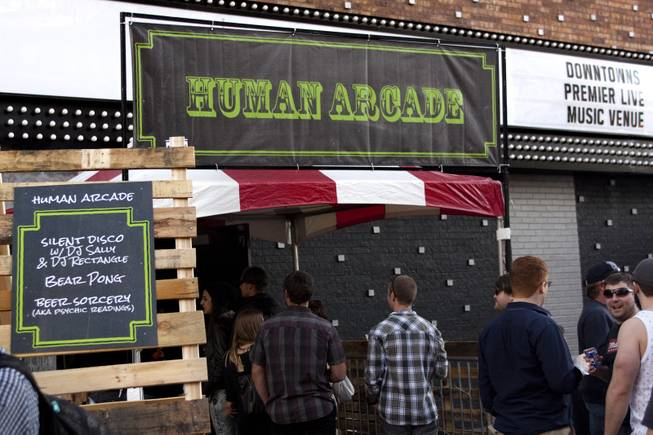 "Festival goers enter the Human Arcade for psychic readings, music and bear pong during the ""Great Vegas Festival of Beer"" gathering on Fremont East Entertainment District Saturday, April 26, 2014."