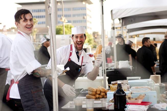 "Cooks at one of the food stands pose for a photo during the ""Great Vegas Festival of Beer"" gathering on Fremont East Entertainment District Saturday, April 26, 2014."