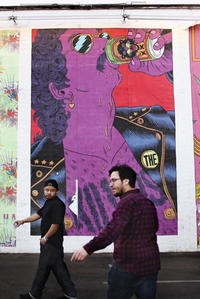 "Featival goers walk past a mural dedicated to The Killers that emulates the night's festivities during the ""Great Vegas Festival of Beer"" gathering on Fremont East Entertainment District Saturday, April 26, 2014."