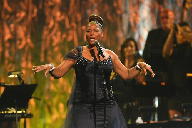 "Recording artist/actress Queen Latifah performs onstage during the 18th annual Keep Memory Alive ""Power of Love Gala"" benefit for the Cleveland Clinic Lou Ruvo Center for Brain Health honoring Gloria Estefan and Emilio Estefan Jr. on Saturday, April 26, 2014, at MGM Grand Garden Arena."