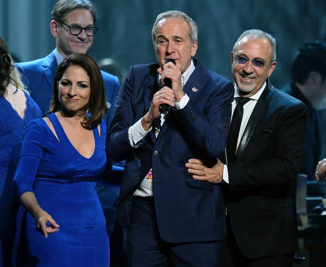 "Honoree Gloria Estefan, Keep Memory Alive founder Larry Ruvo and honoree Emilio Estefan Jr. speak onstage during the 18th annual Keep Memory Alive ""Power of Love Gala"" benefit for the Cleveland Clinic Lou Ruvo Center for Brain Health honoring the Estefans on Saturday, April 26, 2014, at MGM Grand Garden Arena."
