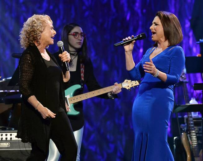"Singer/songwriter Carole King, musician Emily Estefan and honoree Gloria Estefan perform during the 18th annual Keep Memory Alive ""Power of Love Gala"" benefit for the Cleveland Clinic Lou Ruvo Center for Brain Health honoring Gloria Estefan and Emilio Estefan Jr. on Saturday, April 26, 2014, at MGM Grand Garden Arena."