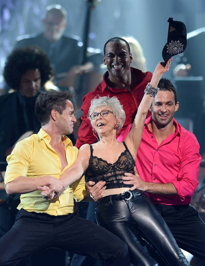 "Actress/singer Rita Moreno performs with dancers during the 18th annual Keep Memory Alive ""Power of Love Gala"" benefit for the Cleveland Clinic Lou Ruvo Center for Brain Health honoring Gloria Estefan and Emilio Estefan Jr. on Saturday, April 26, 2014, at MGM Grand Garden Arena."