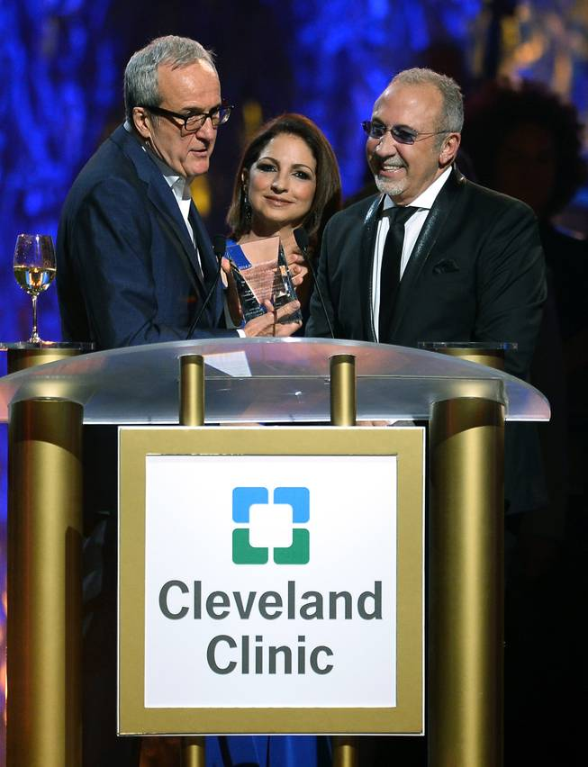 "Keep Memory Alive founder Larry Ruvo and honorees Gloria Estefan and Emilio Estefan Jr. speak onstage during the 18th annual Keep Memory Alive ""Power of Love Gala"" benefit for the Cleveland Clinic Lou Ruvo Center for Brain Health on Saturday, April 26, 2014, at MGM Grand Garden Arena."