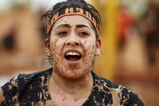 A mud splattered participant is seen during the Tough Mudder event at Lake Las Vegas Saturday, April 26, 2014.