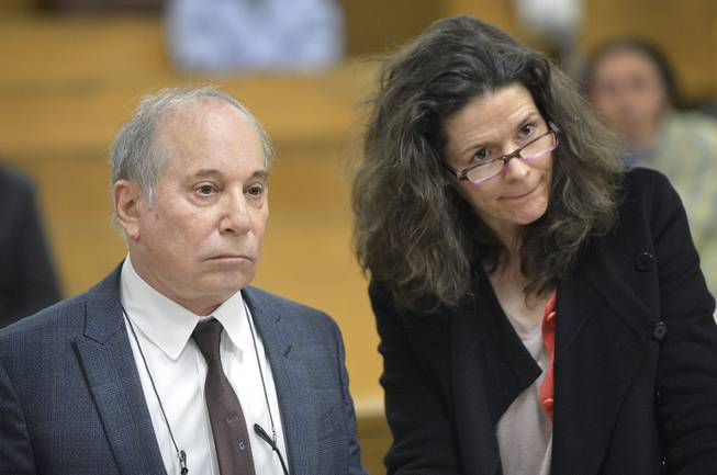 Singer Paul Simon and his wife, singer Edie Brickell, appear at a hearing in Norwalk Superior Court on Monday, April 28, 2014, in Norwalk, Conn. The couple were arrested Saturday on disorderly conduct charges by officers investigating a family dispute at their home in New Canaan, Conn.