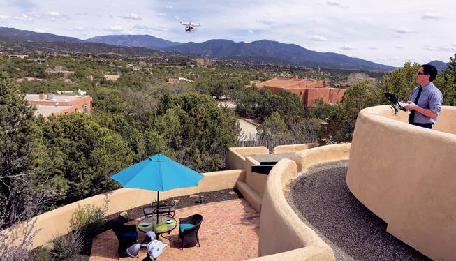 Brian Tercero, of Keller Williams Realty, uses a drone to create a high definition video of a property that he is trying to sell for a client, April 18, 2014. He feels video footage from a drone can better convey the appeal of a property than standard marketing photos.