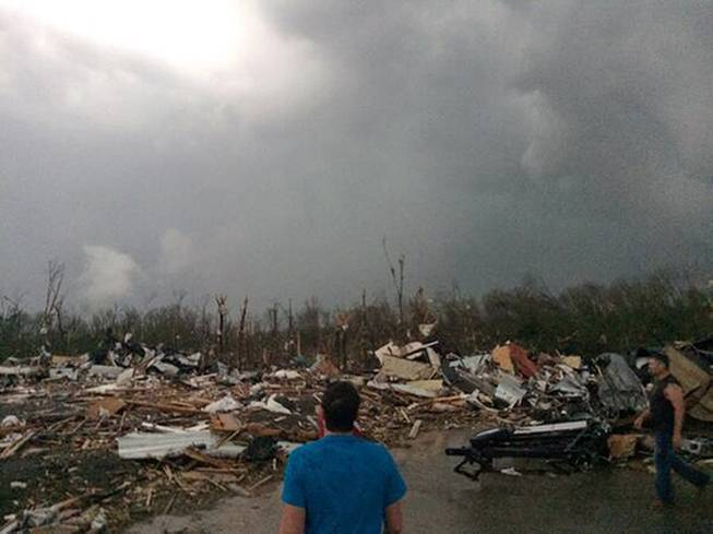 This photo provided by James Bryant shows tornado damage, Sunday, April 27, 2014, in Mayflower, Ark. A powerful storm system rumbled through the central and southern United States on Sunday, spawning several tornadoes, including one in a small northeastern Oklahoma city and another that carved a path of destruction through several northern suburbs of Little Rock, Ark.
