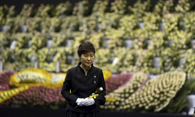 South Korean President Park Geun-hye pays tribute to the victims of the sunken ferry Sewol at a group memorial altar in Ansan, south of Seoul, South Korea, Tuesday, April 29, 2014.