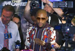 Undefeated WBC welterweight champion Floyd Mayweather Jr. is surrounded by reporters in the lobby of MGM Grand on Tuesday, April 29, 2014. Mayweather will face WBA welterweight champion Marcos Maidana of Argentina at MGM Grand Garden Arena on Saturday.