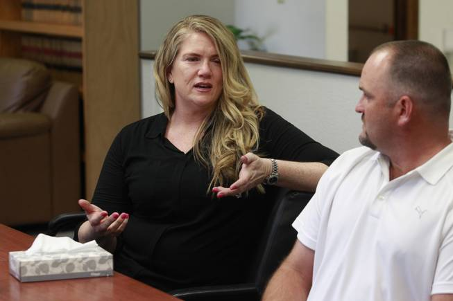 Heath Hairr listens while Mary Bryan talks about the lawsuit filed by the ACLU on their behalf against Clark County school officials Tuesday, April 29, 2014