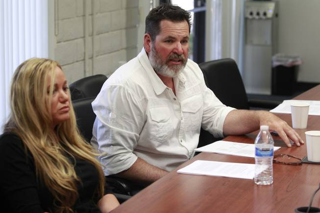 Aimee Hairr listens while Kyle Bryan talks about the lawsuit filed by the ACLU on their behalf against Clark County school officials Tuesday, April 29, 2014