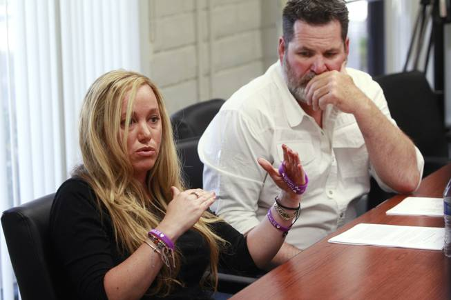 Kyle Bryan listens while Aimee Hairr talks about the lawsuit filed by the ACLU on their behalf against Clark County school officials Tuesday, April 29, 2014.