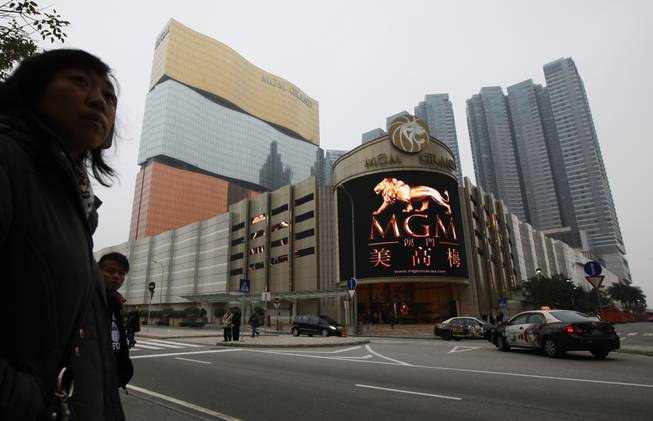This Feb. 15, 2011, file photo shows a promotional screen with the Chinese characters for MGM displayed at the MGM Grand Macau casino resort, in Macau. MGM Resorts reported quarterly earnings on Tuesday, April 29, 2014.